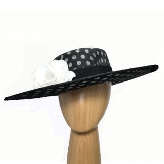 large black polka dot hat