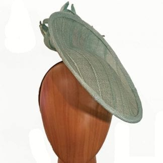 medium, mint green fascinator